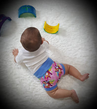 Load image into Gallery viewer, Cute little Bummies, diaper covers for infants and toddlers in sizes 0/3 months through 18/24 months. Lisa Frank inspired.