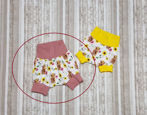 Grow with me shorties for infants and toddlers.  Beautiful sunflowers and Highland Cows, floral print.
