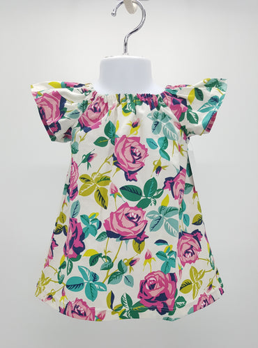 Sweet floral peasant style dress in sizes 12 months, 18 months, 2T, 3T, and 4T. *