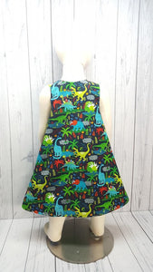 Girls Reversible dress with Dinosaurs on one side and solid green on the reverse. Size 2T *