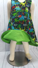 Load image into Gallery viewer, Girls Reversible dress with Dinosaurs on one side and solid green on the reverse. Size 2T *