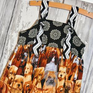 Adorable puppies tossed on this color blocked sleeveless sun dress.  Size 2T *