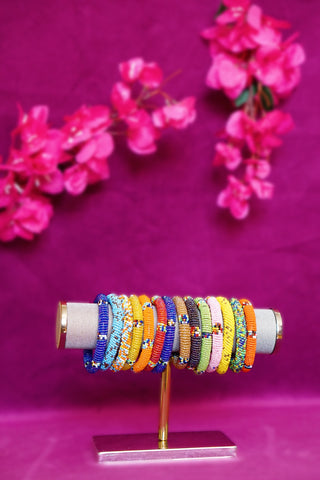Collection of handmade colorful beaded maassai bracelets from Kenya