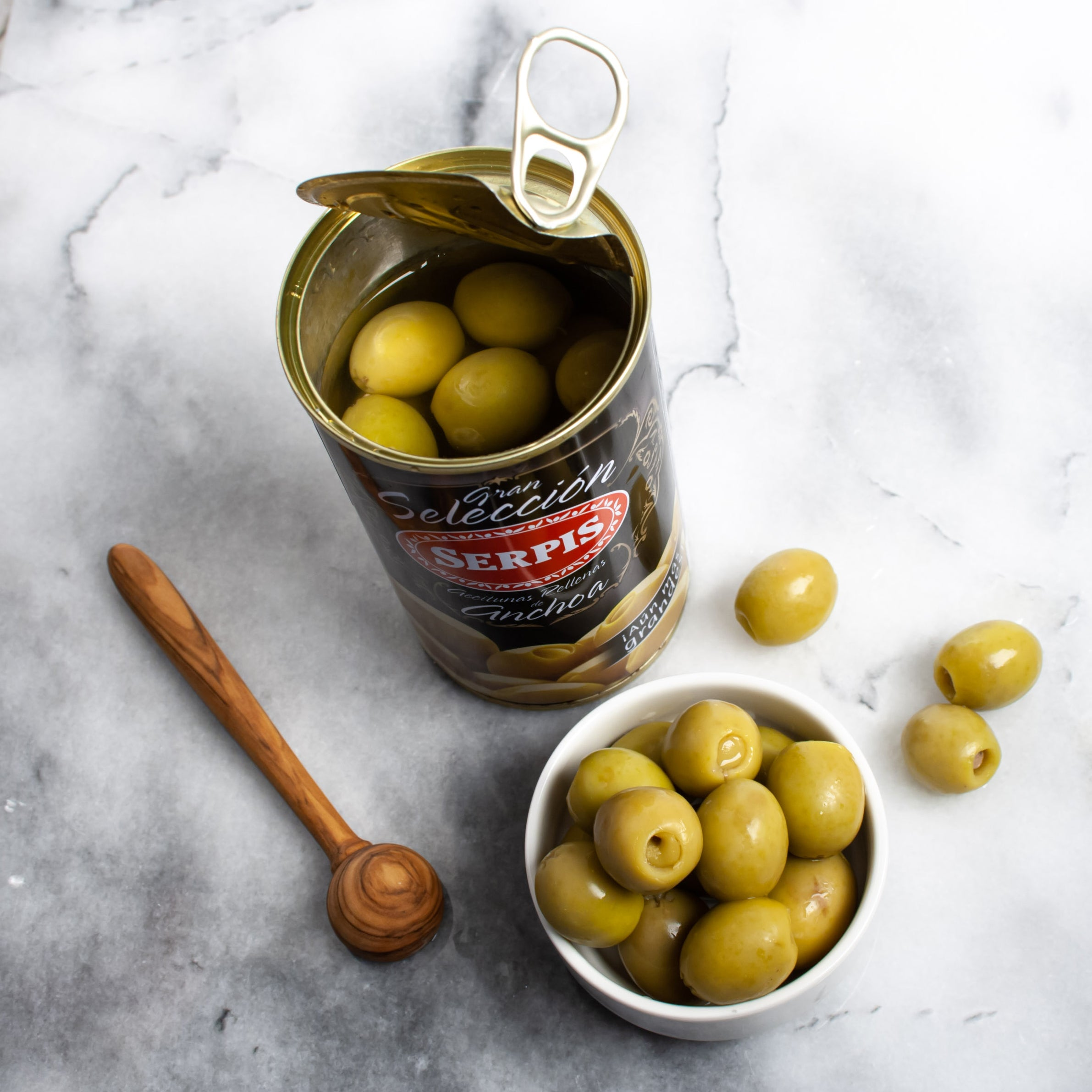 Manzanilla Olives Stuffed with Anchovy - igourmet