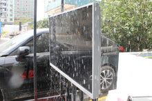 Load image into Gallery viewer, Outdoor 4K UHD weatherproof TV Screen in permanent rain simulator