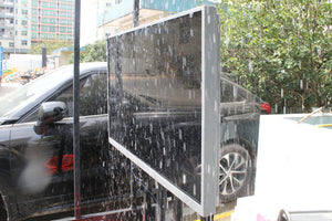 Outdoor 4K UHD weatherproof TV Screen in permanent rain simulator