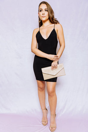 backless in black dress