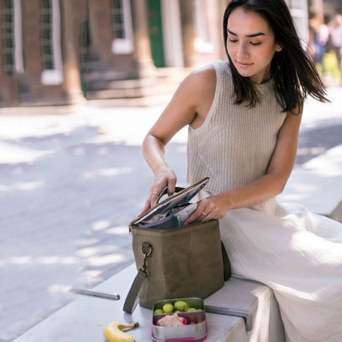 A young woman using an attractive SoYoung Lunch Poche for her healthy lunch.