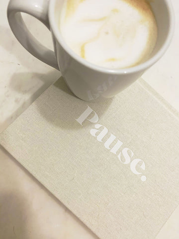Pause meditation journal with coffee