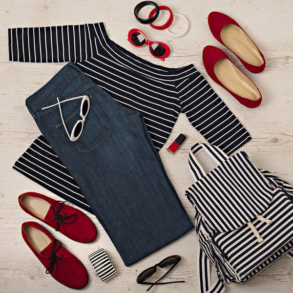 Female summer outfit - navy jeans, striped top, sunglasses, backpack