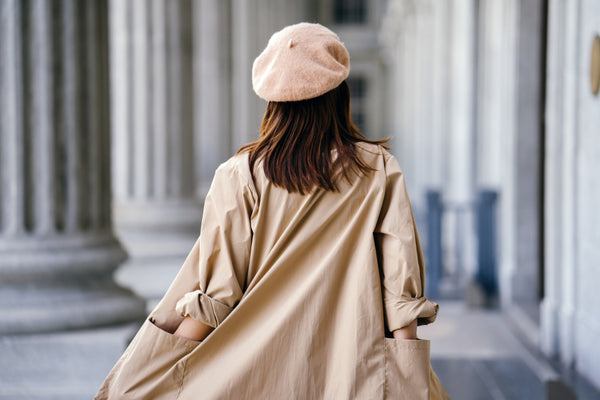 Woman wearing a French trench coat