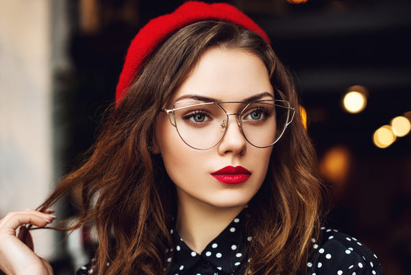 Close up portrait of young woman with red lips makeup