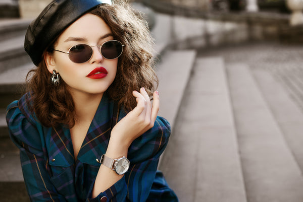 Chic model with bold lipstick and sunglasses