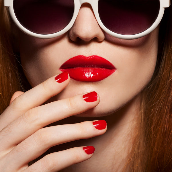 Suave red lipstick on model