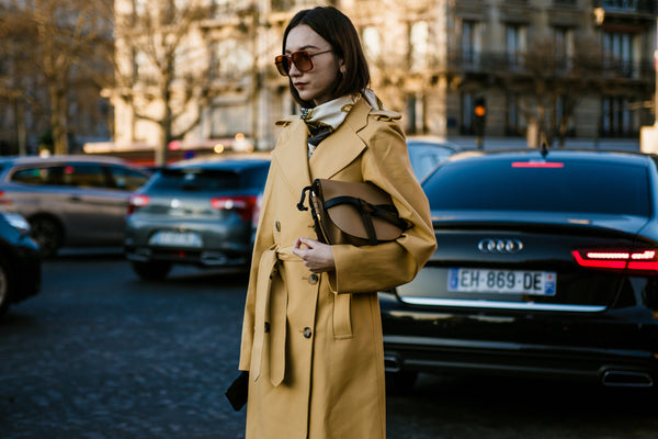 French woman in beige trench coat