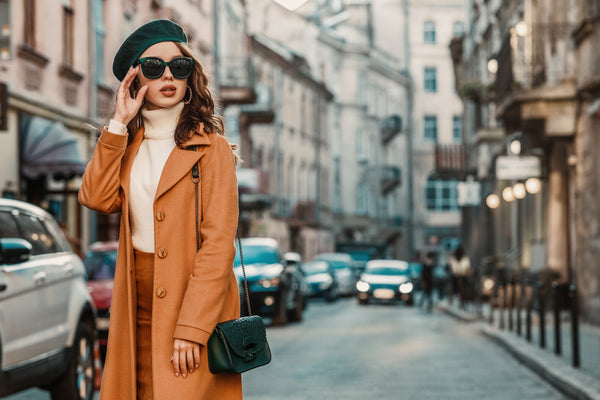 Fashionable French woman wearing trendy sunglasses
