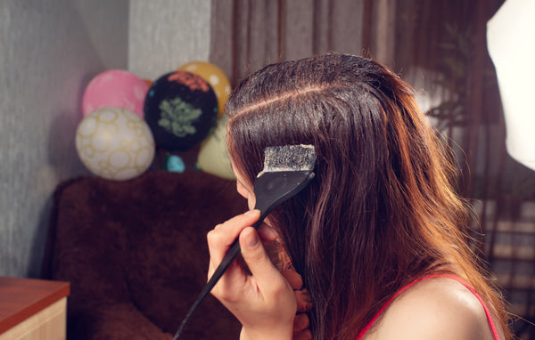 Girl dying her hair at home