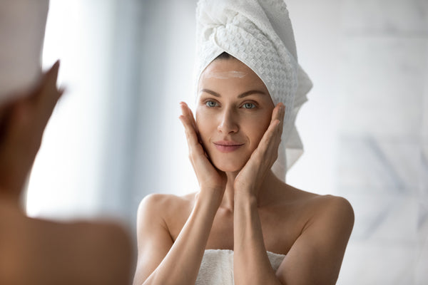 Woman in Towel Moisturizing Face