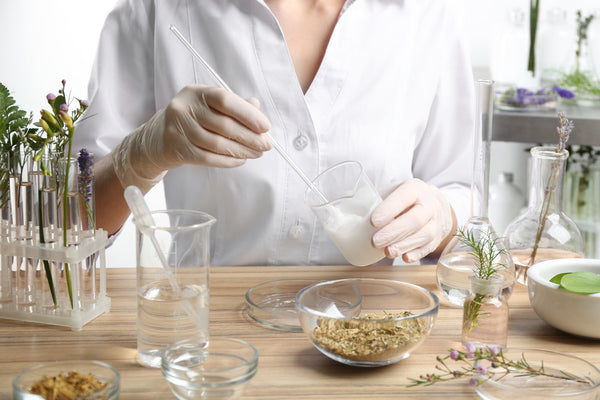 Scientist developing cosmetic product in laboratory