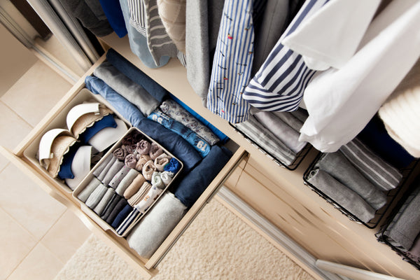 Tidy closet with clothes nicely folded