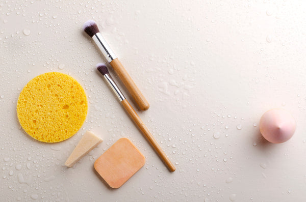 Clean and wet makeup brushes and sponges