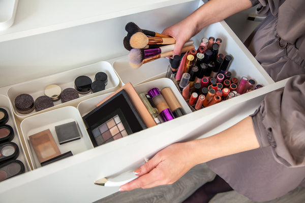 Woman cleaning out a makeup drawer