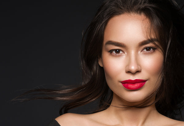 Close-up portrait of model with red lipstick