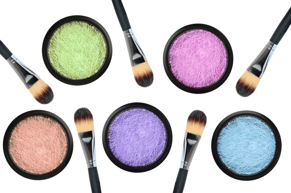Pastel colored makeup and brushes