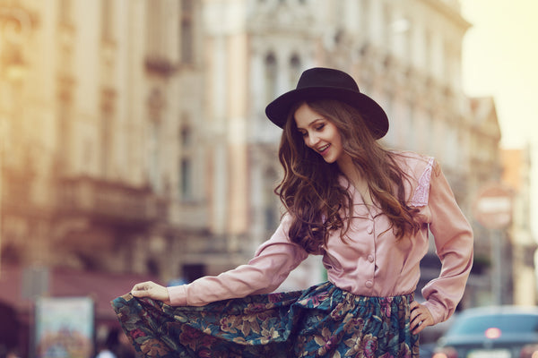 Young and happy model posing in the street