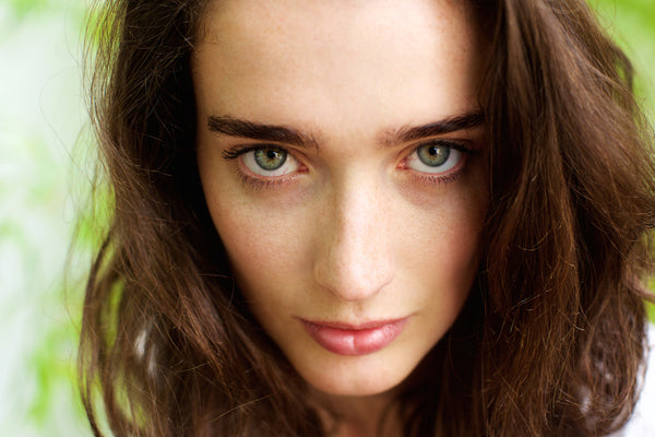 Closeup of model with green eyes