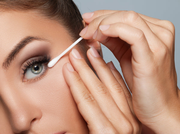 Fixing makeup with a cotton swab