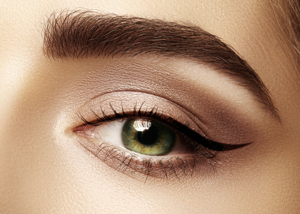 Closeup on eye with natural colored makeup
