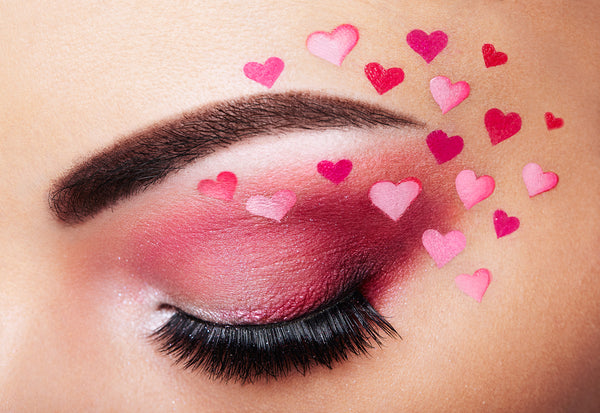 Closed eye with eyeshadow, mascara and heart makeup
