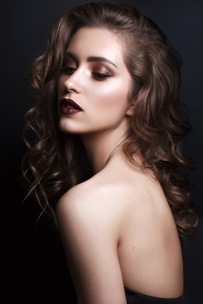 Woman with bronze smokey eye makeup