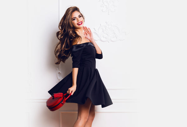Beautiful woman in a dress and classy makeup