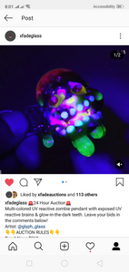Multi-colored UV reactive zombie pendant