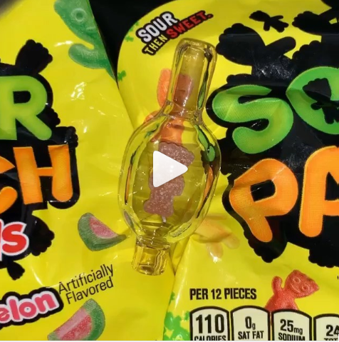 Strawberry sour patch kid trapped in a bubble-cap carb-cap