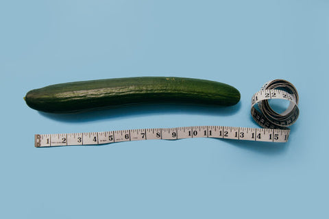 Cucumber next to a tape measure