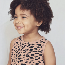 Curly haired child smiling wearing Abstract Animal Kids Shortie romper | Little Oeuf