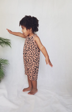 Child simulating flying pose wearing short sleeve Abstract Animal Kids Shortie romper | Little Oeuf
