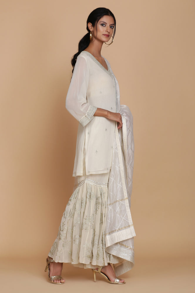IVORY SHORT TUNIC WITH HEAVY EMBROIDERED GHARARA AND DUPATTA