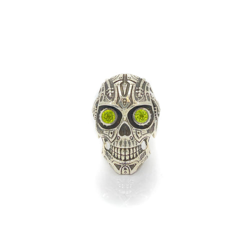 This is Peridot Skull Ring in Sterling Silver with intricate detail, looking like something straight out of Terminator. The Peridot eyes make this piece really pop when sparkling in the light