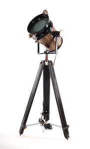 Antique search light with black antique wood tripod stand