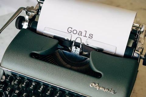 GOALS spelled out on a piece of paper in an old typewriter