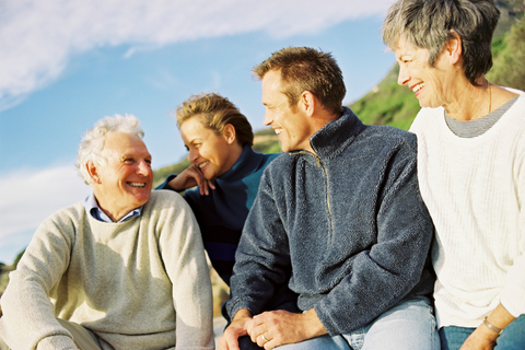 Older man and woman with middle aged man and woman enjoying the sunshine