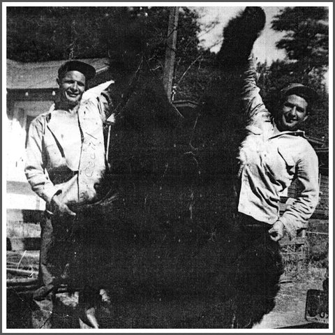 Cecil Phillips holding a bear in Northern California.