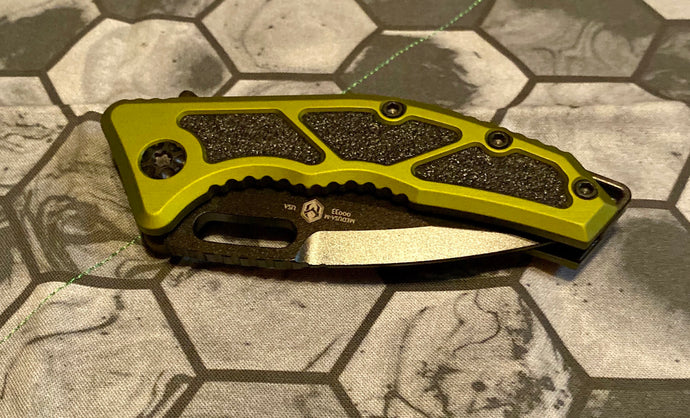 Heretic Knives manual flipper Medusa with green handles
