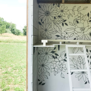 I painted a floral mural inside a chicken coop. Yep. A chicken coop.