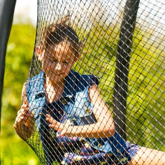 Girl bouncing onto Jumpflex™ soft-touch net