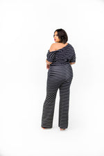 Black and White stripe one off shoulder jumpsuit, relaxed fit with 3/4 length sleeves, self waist tie belt, side pockets, and wide legs.